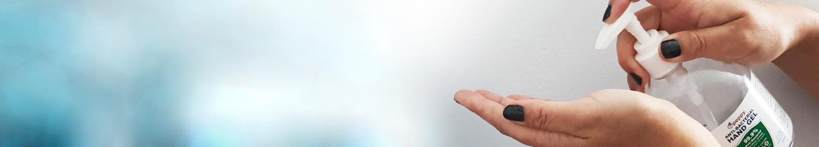 Hands using PeppyPure Hand Sanitiser